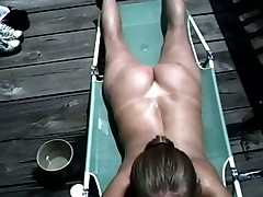 Blowjob while taking a sunbath