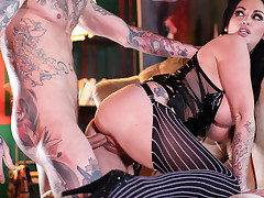 Sexy bitch in stocking is fucked by heavily tattooed man.