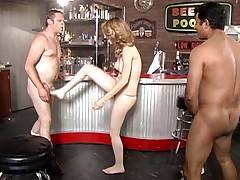 She takes on 2 men in a game of cocks and balls domination !