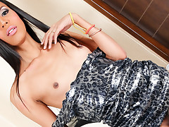 Horny shemale Nicole, strips and strokes her massive cock