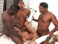Filty whore gets three black dude to fuck her holes in here
