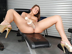 Abby Cross masturbates with massive dildos in the gym!