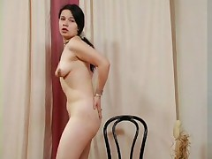 Amateur brunette strips and plays for the camera