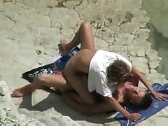 Couple spied on a beach