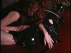 Redhead Sasha Sits On Latex Gimp's Face