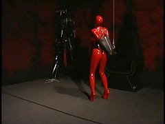 Helpless Fetish Babe Tied Down In PVC