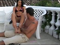 Very attractive mature woman uses her feet