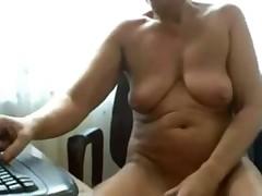 Horny granny toying on webcam