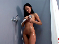 Solo girl Brenda Black with unshaved kitty is rubbing her twat in the bath