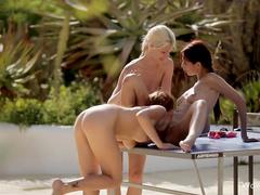 Three slender lesbians are having outdoor threesome