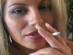 Big titty beauty smokes and strips solo