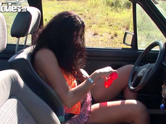 Curly brunette masturbation in parked car