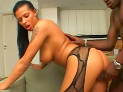 Tanned babe in nylons is fucking in her shaved pussy