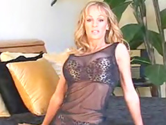 Curly blonde Tanya Danielle takes off her dress