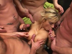 Awesome blonde is being fucked by gang