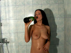 European brunette is playing with a bottle
