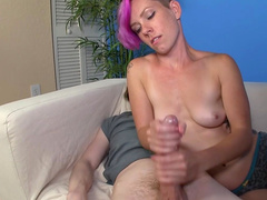 Pink-haired cutie is wanking a dick