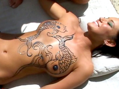 Sexy tanned babes with tattoos are fucking