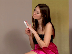 Dildo-sucking brunette Kattie Gold is playing with toys