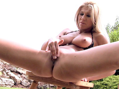 Blonde in bikini with high heels Clara Hamilton shows off her trimmed pussy