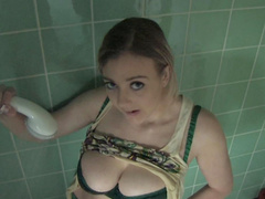Sweet blonde Sapphire poses in her shower