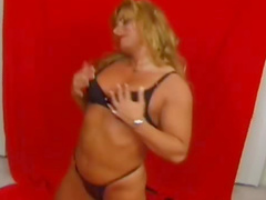 Muscular Athena is satisfying her fresh crotch after sport exercises