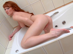 Redhead beauty Polina is penetrating her nasty vagina