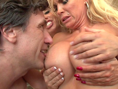 Blondes with big boobies are giving a deep blowjob