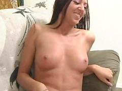 Brunette Misty Magenta is poking her shaved pussy