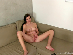 Slender brunette gets a cumshot in her face