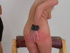 Bound girl paddled on the ass