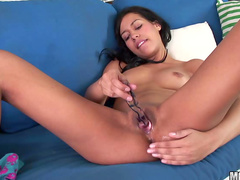 Spicy babe Courtney Page is playing with a glass dildo