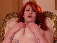 Redhead Paige Delight is showing her sexy pussy