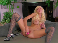 Blonde with fake tits Casey James shows off her shaved pussy