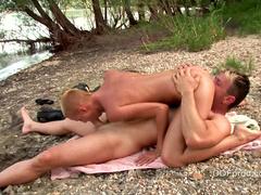 Bald babe C.J fucks on the cute beach