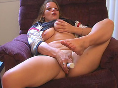 Busty babe Stephanie is posing and masturbating in the chair