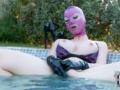 Latex chick gets in the pool for fun