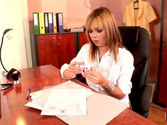 Brunette Nikita is masturbating in her office