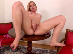 Blonde Kala Ferard is taking off her nice sexy nylons