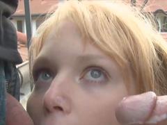 Slender blonde Laura is sucking two poles
