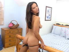 Tanned babe Lucie plays with her vagina