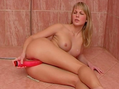 Hardcore blonde is fucking with big red dildo