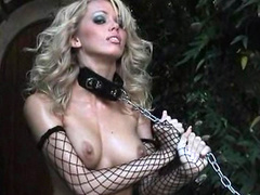 Glamorous blonde Lonnie Waters is playing with her boobies