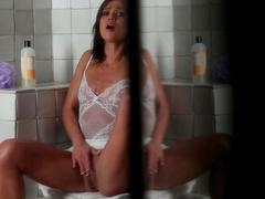 Brunette Alyssa Reece fingers in the toilet