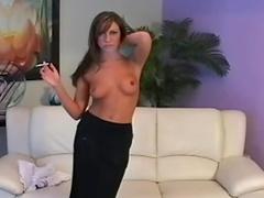 Stockings and garter belt girl smokes cigarette