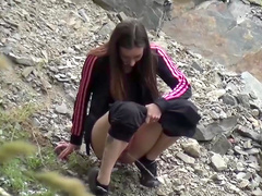 Pissing teens playing in outdoor