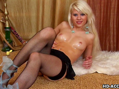 Smiling blonde Emanuel pokes her pretty sexy pussy