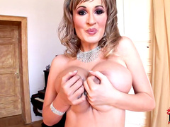 Sweet big titted blonde is demonstrating her big tits