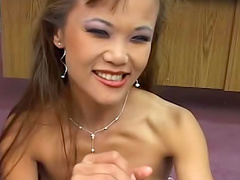 Whore makeup on cute Asian handjob slut