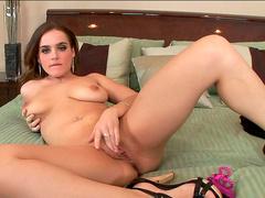 Natasha Nice is poking her cute looking pussy with pleasure